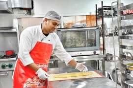 The ever smiling Chef Dilli from Nepal preparing his honeycomb