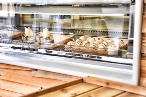 The glass shelves of the bakery are always filled with miniature desserts ready to be picked up by visitors