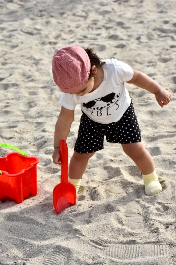 Tiny toes digging into the gritty wet sand for the first time